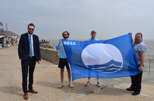 Blue Flag 2021 on Walton seafront with Councillor Alex Porter, Ben Burrows, Henry Speck and Scott Lawrence