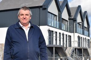 Councillor Paul Honeywood by the new homes in Jaywick Sands