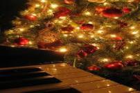 Piano and Christmas Tree with lights on